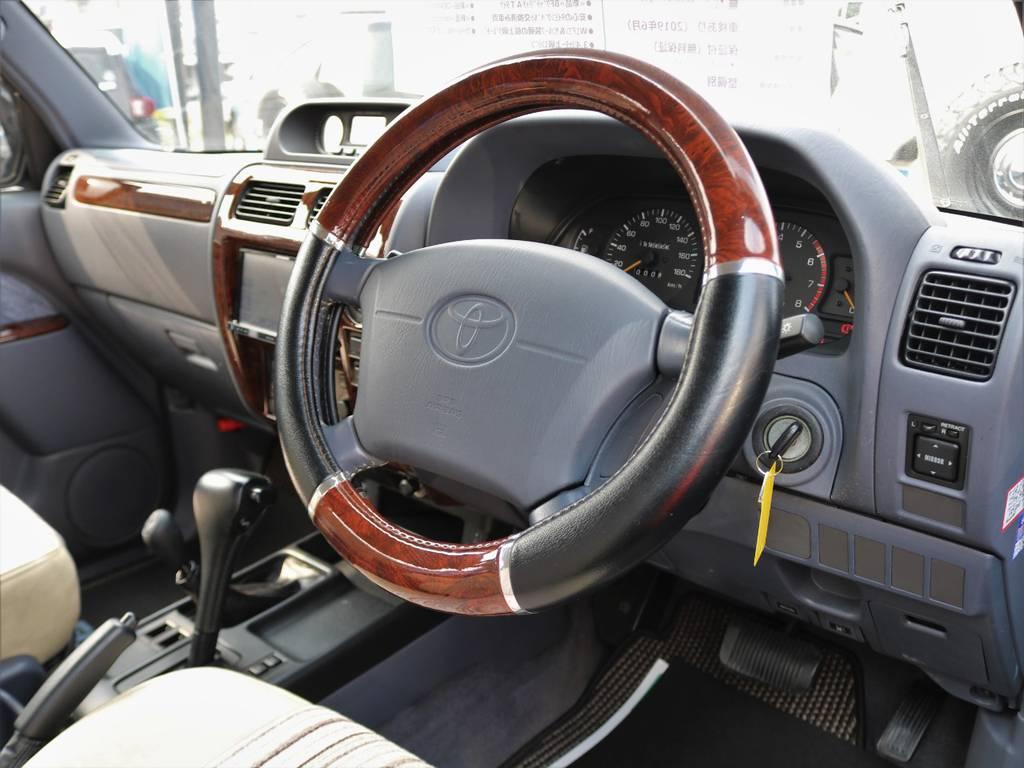 新品ウッドステアリングへの交換も承っております! | トヨタ ランドクルーザープラド 3.4 TZ 4WD サンルーフ Wエアコン タイベル換済