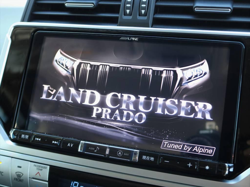 9インチの大画面ナビは地図の情報量が多く、テレビもバックカメラの映像も鮮明に映ります。Bluetoothオーディオにも対応! | トヨタ ランドクルーザープラド 2.7 TX Lパッケージ 4WD 7人