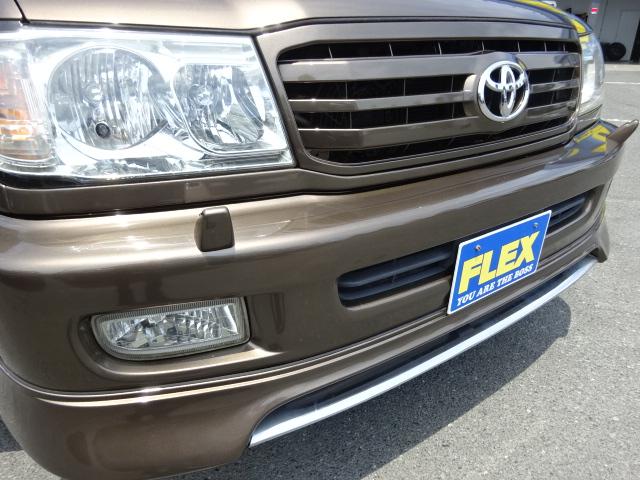 リップスポイラー付きで高級感がありますね!   トヨタ ランドクルーザー100 4.7 VXリミテッド 4WD セパンブロンズオールP 新品22AW