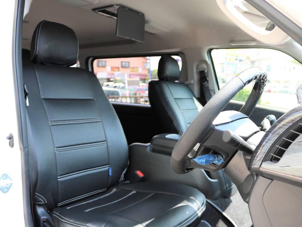 室内は黒革調シートカバーで高級感が向上し、お手入れもし易くなっております! | トヨタ ハイエース 2.7 GL ロング ミドルルーフ 新型 TSS 試乗車